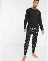 Polo Ralph Lauren – e Jogginghose und langärmliges T-Shirt als Set mit Wappenlogos bedruckt - Schwarz