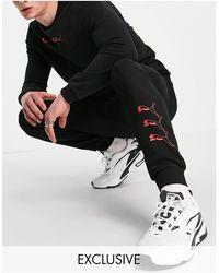 PUMA Черные Джоггеры С Повторяющимся Логотипом – Эксклюзивно Для Asos-черный