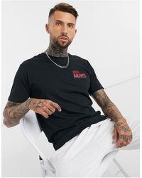 New Balance Speed - T-shirt nera con logo - Nero