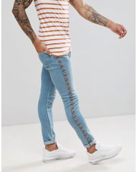 ASOS - Super Skinny Jeans In Light Wash Blue With Abrasions With Aztec Side Stripe - Lyst