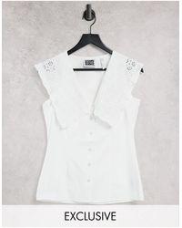 Reclaimed (vintage) Camisa blanca sin mangas con cuello llamativo - Blanco