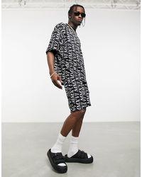 ASOS Shorts pitillo negros con estampado