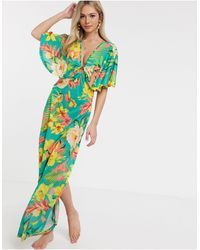ASOS Slinky Jersey Beach Maxi Dress With Ring Detail In Oversized Tropical Floral Print - Green