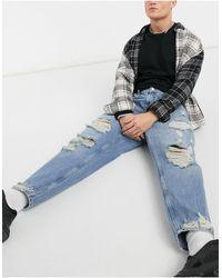 Bershka Jeans larghi blu con strappi