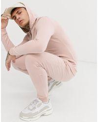 ASOS Chándal rosa muy ajustado con sudadera con capucha y joggers