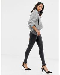 Spanx – Figurformende Leggings aus Kunstleder mit hoher Taille - Schwarz