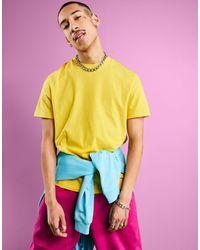 ASOS Camiseta en tejido orgánico con cuello redondo en amarillo