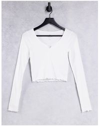 Hollister T-shirt manches longues à bord ondulé - Blanc