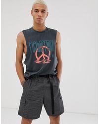 ASOS – Lässiges Trägershirt aus Bio-Baumwolle mit tiefen Armlöchern und Friedensdruck - Schwarz