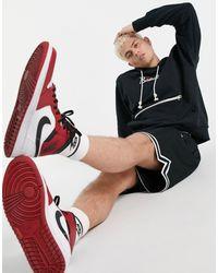 Nike Basketball – Standard Issue – er Kapuzenpullover - Schwarz