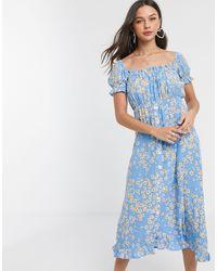 Faithfull The Brand Faithfull Ina Floral Short Sleeve Midi Dress With Button Front - Blue