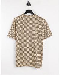 River Island T-shirt slim cuoio con monogramma - Marrone