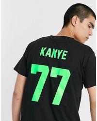 LES (ART)ISTS Les (art)ists Kanye 77 Fluro Football T-shirt - Black