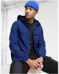 ASOS - Cortavientos con capucha en azul cobalto - Lyst
