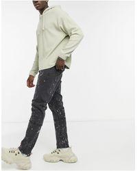 Liquor N Poker Spliced Jeans With Paint Splatter Effect - Black