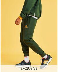 New Balance In esclusiva per ASOS - Pantaloni della tuta verdi con logo - Verde