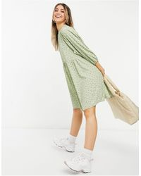 Monki Vestido corto verde amplio con estampado floral