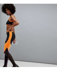 PUMA - Exclusive To Asos Panelled Legging In Black And Orange - Lyst