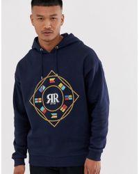 ASOS Hoodie oversize avec logo drapeau brodé sur la poitrine - Bleu