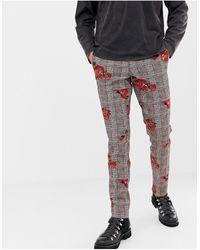Heart & Dagger Pantaloni skinny con stampa a quadri con rose - Rosa