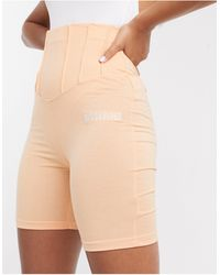 Missguided Pantalones cortos estilo leggings en naranja con detalles estilo corsé