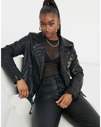 Blank NYC Love and Leave - Blouson style motard en imitation cuir à clous et motif fleuri - Noir