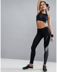ELLE Sport - Pannel Zip Pocket Gym Joggers - Reflective Print - Lyst