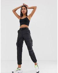 Bershka - Pantalon fonctionnel avec ceinture - Noir - Lyst