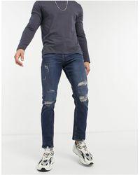 New Look Jeans slim lavaggio blu scuro con strappi
