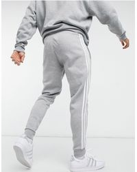 adidas Originals Серо-лиловые Зауженные Джоггеры С Тремя Полосками Adicolor-серый