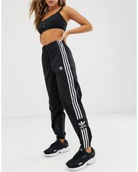 adidas Originals Adicolor Locked Up - Trainingsbroek Met Logo - Zwart