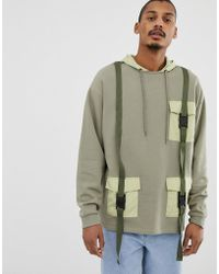ASOS Oversized Hoodie With Military Pockets And Styling In Green