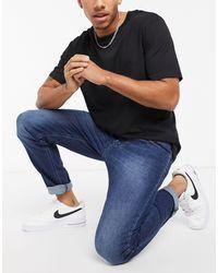 DIESEL Larkee-Beex - Jeans regular affusolati lavaggio scuro - Blu