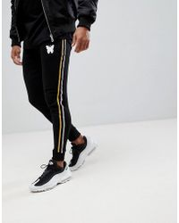 Good For Nothing Skinny Joggers In Black With Side Stripes