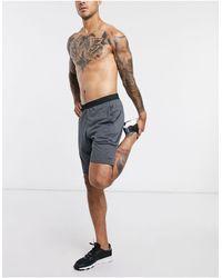 Reebok Pantaloncini da allenamento - Grigio