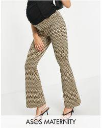 ASOS - Asos design maternity - pantalon évasé en jacquard avec bande recouvrant le ventre et rayures ondulées - Lyst