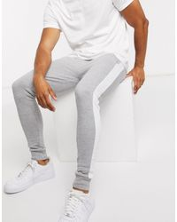 ASOS Skinny joggers With Side Stripe - Grey
