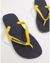 Havaianas - Brasil Logo Flip Flops In Navy And Yellow - Lyst