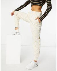 Lacoste Joggers crema con logo a monogramma - Bianco