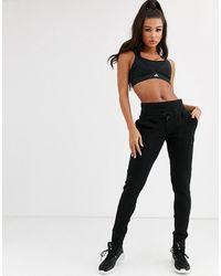 adidas Originals Adidas - Varsity Primeknit - Sweatpants - Zwart