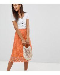 ASOS Asos Design Tall Polka Dot Print Midi Skirt With Embroidered Hem - Orange