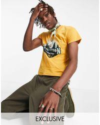 Reclaimed (vintage) Inspired - T-shirt coupe rétro avec motif paysage - Orange