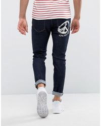 Love Moschino Jeans With Peace Logo In Slim Fit - Blue