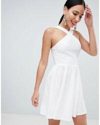314abefe9815 ASOS Asos Design Maternity Cross Neck Bandage Mini Skater Dress in White -  Lyst