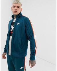 Nike Tribute - Trainingsoberteil - Blau