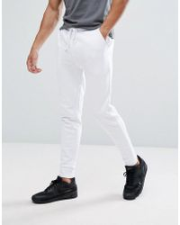 ASOS - Skinny Joggers In White - Lyst
