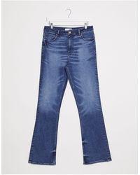 ASOS - Jeans a zampa slim vita alta lavaggio blu medio - Lyst