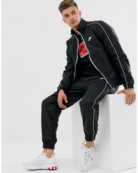 Nike Gewebter Trainingsanzug in Schwarz