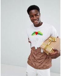 c7455501181b7 ASOS - T-shirt de Noël oversize avec imprimé gâteaux traditionnels de Noël  et houx