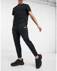 Pull&Bear Paint Splatter joggers - Black